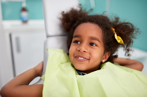Adorable Black girl waiting to get a dental exam at Atlantic Dentistry in Jacksonville, FL